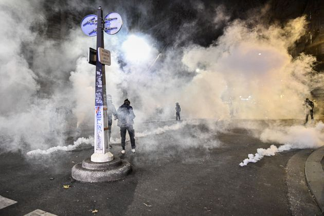 Police Disperse Anti Global Security Law Protesters With Tear Gas In Paris - SurgeZirc France